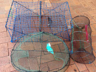 A collection of three different seized illegal recreational fish traps